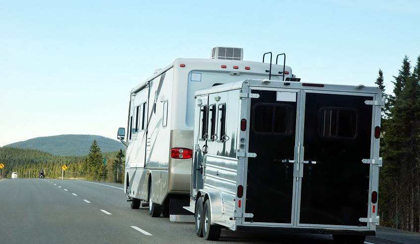 RV and trailer going down the road.